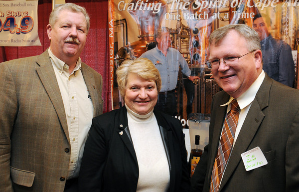 Danvers:<br /> From left, Bob Ryan of Ryan & Wood, Inc. Distilleries, Anna Kulakowski of East Boston Savings Bank, and Jim Moran of Securitas attend the North Shore Business Expo at the Double Tree by Hilton on Tuesday.<br /> Photo by Ken Yuszkus/The Salem News, Tuesday, March 5, 2013.