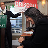 "Salem:<br /> State representative John Keenan displays a political sign stating ""Kim Driscoll for governor"" which gets a laugh from Mayor Driscoll during Rep. Keenan's St. Patrick's breakfast.<br /> Photo by Ken Yuszkus/The Salem News, Friday, March 15, 2013."