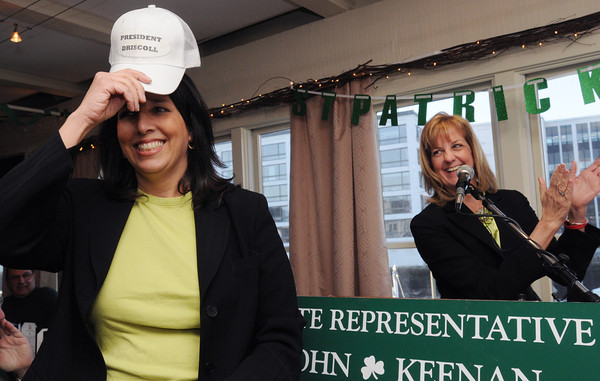 """Salem:<br /> Mayor Kim Driscoll tries on a hat with the wording """"President Driscoll"""" which was one of the hats given to her by state senator Joan Lovely, right, during Rep. Keenan's St. Patrick's breakfast.<br /> Photo by Ken Yuszkus/The Salem News, Friday, March 15, 2013."""