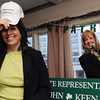 "Salem:<br /> Mayor Kim Driscoll tries on a hat with the wording ""President Driscoll"" which was one of the hats given to her by state senator Joan Lovely, right, during Rep. Keenan's St. Patrick's breakfast.<br /> Photo by Ken Yuszkus/The Salem News, Friday, March 15, 2013."