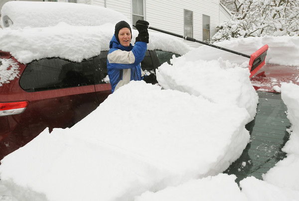 Beverly:<br /> Paul Mulligan of Beverly happily watches as a large section of snow slides off the top of his car while he was clearing it off after the snowstorm.<br /> Photo by Ken Yuszkus/The Salem News, Tuesday, March 19, 2013.
