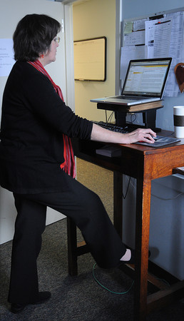 Wenham:<br /> Director of publications Patty Hanlon stands while working on her computer at Gordon College.<br /> Photo by Ken Yuszkus/The Salem News, Wednesday, March 6, 2013.