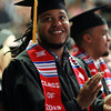 Salem: Salem State University graduate Socrates Garcia smiles and claps while glancing up at the big screen during Commencement on Saturday afternoon. David Le/Salem News