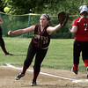 Marblehead:<br /> Newburyport's first baseman Carley Siemasko reaches for the throw as Marblehead's Michaela Leblanc gets to first safe during the Newburyport at Marblehead Division 2 North tournament softball.<br /> Photo by Ken Yuszkus, Salem News, Thursday May 30, 2013.