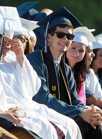 Peabody: Peabody High School graduate Alex Guay smiles as he listens to Peabody Mayor Ted Bettancourt  give his opening remarks on Friday evening. David Le/Salem News