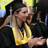 Swampscott: 2013 Marian Court College graduate Courtney Pfifferling applauds student speaker Gabriel Santiago, during Commencement on Wednesday evening. David Le/Salem News