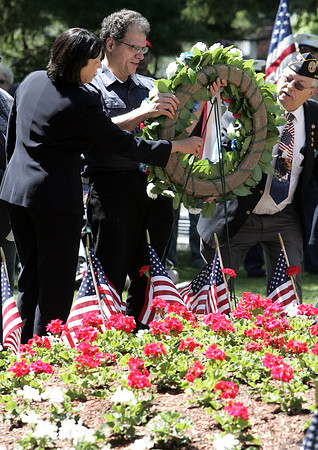 Salem:<br /> From left, Salem Mayor Driscoll, James Ayube, and Commander of the Salem Veterans Council Robert Leger, place a wreath during Salem's Memorial Day ceremony in Greenlawn Cemetery. Christina Ayube assisted, but is hidden in the photo.<br /> Photo by Ken Yuszkus/Salem News, Monday May 27, 2013.