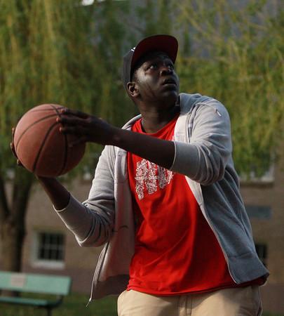 Marblehead: Abdou Sene, 18, of Marblehead, plays pickup basketball at Seaside Park on Thursday evening. David Le/Salem News