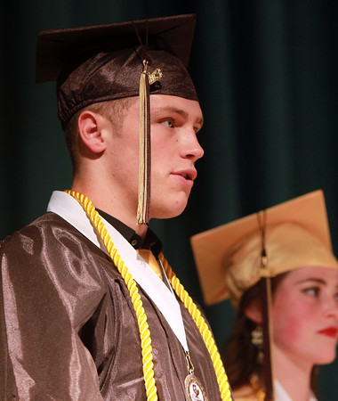 Peabody: Bishop Fenwick senior class Vice-President Fran Hannon announces the senior class gift during Commencement on Friday evening. David Le/Salem News