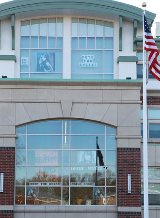 Beverly: Signs decorate the front windows of Beverly High School supporting 2012 BHS graduate Angie Miller who is one of the last four contestants on this season of American Idol. David Le/Salem News