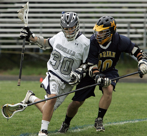 Hamilton:<br /> Hamilton-Wenham's Sam Petri, left, is covered by Marian's Zach Mooore during the Marian at Hamilton-Wenham boys tournament lacrosse game.<br /> Photo by Ken Yuszkus, Salem News, Wednesday May 29, 2013.