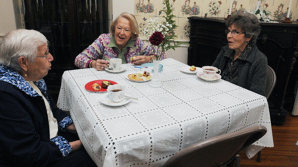 Salem:<br /> From left, Harriet Diamond, Joanne Caverly, and Marcia Olsson attended the annual Florence Cobb Coffee hosted by the Woman's Friend Society which was held at the Emmerton House Wednesday morning. Proceeds support Emmerton House, Brookhouse Home for Women and Plummer Home for Boys.<br /> Photo by Ken Yuszkus/Salem News, Wednesday June 8, 2013.