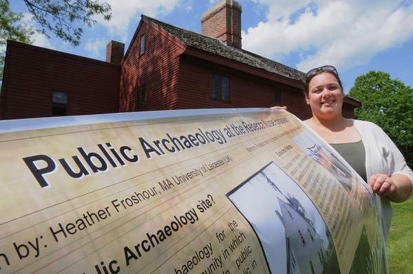 Danvers:<br /> Resident caretaker Candice Clemenzi holds one of the posters for the grand opening of the Rebecca Nurse Homestead archaeology exhibit while she stands in front of the homestead.<br /> Photo by Ken Yuszkus, Salem News, Thursday May 30, 2013.