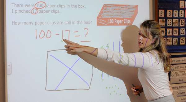 Danvers:<br /> Teacher Jessica Forsberg use the Interactive whiteboard to boost math skills in her 2nd grade classroom at the Smith School in Danvers.<br /> Photo by Ken Yuszkus/Salem News, Thursday June 9, 2013.