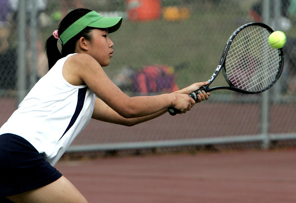 Peabody:<br /> Peabody's Winger Ma competes in a singles match at the Beverly at Peabody girls tennis match.<br /> Photo by Ken Yuszkus/Salem News,  Monday May 20, 2013.
