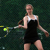 Marblehead: Marblehead first singles player Tory Booth returns a volley while playing Manchester-Essex on Thursday evening at Seaside Park. David Le/Salem News