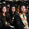 Salem: Salem State graduates watch student speaker Ahmadou Balde give his speech on the big screen inside the O'Keefe Center on Saturday afternoon. David Le/Salem News