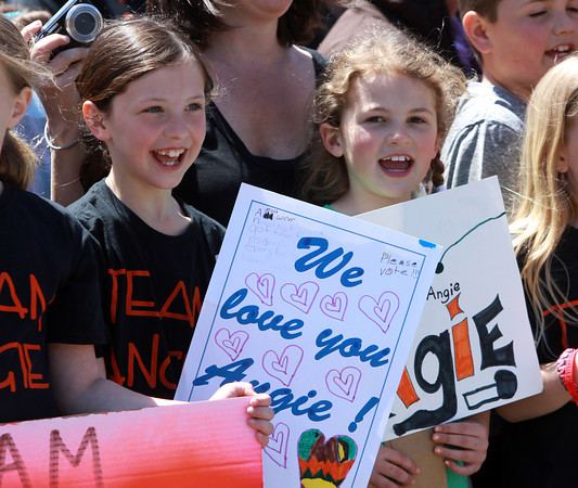 Beverly: Eight-year-olds Samantha Jones and Kayla Bello hold up signs supporting Beverly native Angie Miller as they wait for her to arrive at the Centerville Elementary School on Saturday afternoon. David Le/Salem News