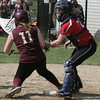 Marblehead:<br /> Newburyport's Shelby O'Brien is safe at home as Marblehead's catcher Emily Messinger guards the plate during the Newburyport at Marblehead Division 2 North tournament softball.<br /> Photo by Ken Yuszkus, Salem News, Thursday May 30, 2013.