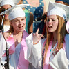 "Peabody: Peabody High School graduates Julianna Silvagni, left, and Dana Sheridan, sing along to ""Some Nights"" by Fun. during their last performance with the PVMHS Chorus at Graduation on Friday evening. David Le/Salem News"