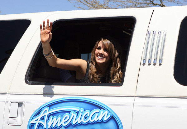 Beverly: Beverly native Angie Miller waves out of the window of an American Idol limousine as she arrives at Centerville Elementary School on Saturday afternoon. Miller, as one of the final 3 contestants on American Idol, returned to her hometown, visiting her old school, parading through downtown Beverly, and finally giving a concert for thousands of fans outside her alma mater, Beverly High School. David Le/Salem News