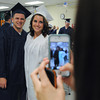 Middleton:<br /> From left, North Shore Tech grads Jared Farese of Salem and Kourtney Kellard of Danvers have their photo taken by Kayla Morgan of Salem while they are getting ready for the graduation ceremony to begin.<br /> Photo by Ken Yuszkus, Salem News, Thursday May 30, 2013.