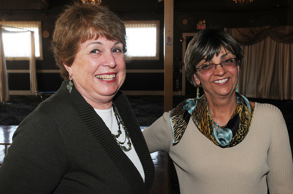 """Danvers:<br /> Dale Miller-Bouton, left, EEC teacher at the Memorial Building, and Pam Fall, retired teacher, attend the Beverly Teachers Association """"Celebration of Excellence"""" champagne reception held at the Danversport Yacht Club.<br /> Photo by Ken Yuszkus/Salem News, Tuesday June 7, 2013."""