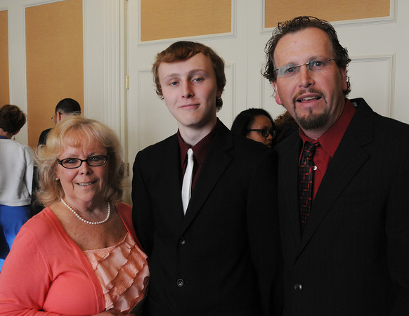 Danvers:<br /> From left, Linda Stoey, grandmother of Trevor Forsythe, scholar from Peabody Veterans Memorial High School, and Tray Forsythe, father of Trevor, all of Peabody, attend the Chamber of Commerce Honors Scholar dinner, honoring the region's top graduating high school scholars, held at the Double Tree Hotel.<br /> Photo by Ken Yuszkus/Salem News, Tuesday June 14, 2013.
