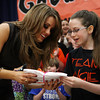 Beverly: Beverly native and American Idol Finalist, Angie Miller, receives a t-shirt from eleven-year-old Ella Colten, during a visit to the Centerville Elementary School. David Le/Salem News