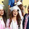 Peabody: Peabody High School chorus seniors Stephanie Parsons, Krista Caproni, and Andrew Truong, sing together for the last time at Graduation on Friday evening. David Le/Salem News