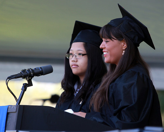 Wenham: Gordon College Senior Class Representatives Teresa Baik, left, and Katie Stapleton, right, present the Senior Class Gift during Commencement on Saturday morning. David Le/Salem News