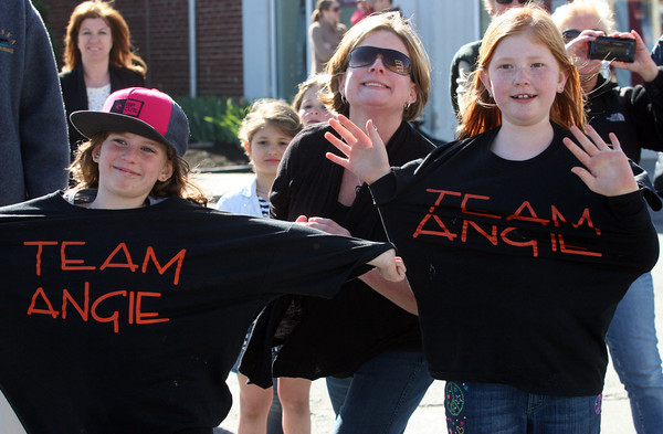 Lyza Parsons/Staff photo<br /> Sophia  Parisella, left, and Grace Coughlin wear their team Angie shirts as they cheer Angie Miller, a finalist in American Idol, as she heads down the parade route in Beverly.