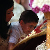 Peabody: Eleni Palm, of Salem, holds her son Christian, 6, so he can kiss a cloth with a painted icon of Jesus Christ after a Good Friday ceremony at St. Vasilios Greek Orthodox Church on Friday afternoon. David Le/Salem News
