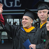 Beverly:<br /> Graduate Chris Lippi waves toward the stands during the processional at the stadium at Endicott College's graduation ceremony. <br /> Photo by Ken Yuszkus/Salem News, Friday May 24, 2013.
