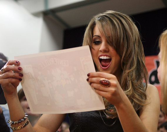 Beverly: Beverly native Angie Miller reacts to an old class photo from the Centerville Elementary School during a visit on Saturday afternoon. Miller, a top 3 Finalist on American Idol, returned to her hometown where she was greeted by thousands of fans and supporters. David Le/Salem News