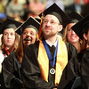 Salem: Travis Earle smiles as he listens to classmate Ahmadou Balde give the student address at Commencement on Saturday afternoon. David Le/Salem News
