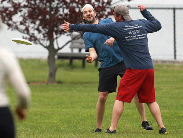 Beverly: Greg Cantwell, left, throws a pass around Matt Tries, during a pickup game of ultimate frisbee at Lynch Park in Beverly on Tuesday evening. David Le/Salem News