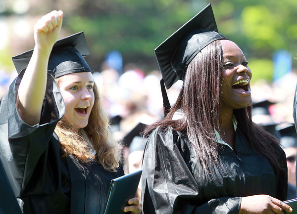 Wenham: Gordon College graduates Chelsea Revell and Beatrice Donkoh cheer loudly as some of their classmates receive their degrees on Saturday morning. David Le/Salem News