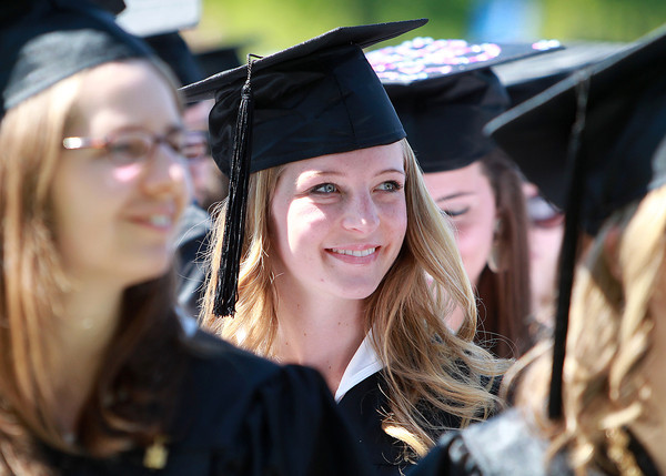 Wenham: Gordon College graduate Rebecca Kearney smiles as she listens to Gordon College President D. Michael Lindsay give his welcoming remarks at the start of Commencement on Saturday morning. David Le/Salem News
