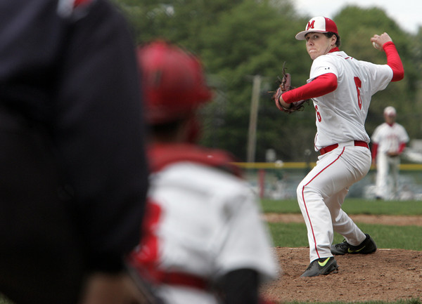 Topsfield:<br /> Masconomet pitcher Will Twiss winds up for a pitch during the Pentucket at Masconomet baseball game.<br /> Photo by Ken Yuszkus/Salem News, Tuesday June 14, 2013.