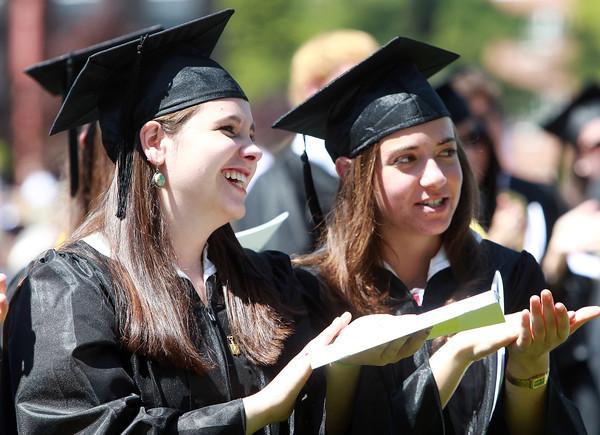 Wenham: Gordon College graduates Amaris Buchanan and Rachel Ashley clap for Honorary Degree recipient Dr. Benedito Aguiar Neto, during Commencement on Saturday morning. David Le/Salem News