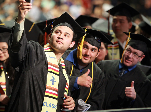 Salem: Salem State graduate Edder Berreondo, left, takes a photo of himself and classmates Evan Chand and Brian Condon, prior to the start of Commencement on Saturday afternoon. David Le/Salem News