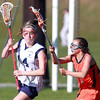 Peabody: Peabody's Megan Poverman, left, tries to get past Beverly's Alicia Cecchini, right, during the second half of play on Friday afternoon. David Le/Salem News