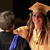 Peabody: Bishop Fenwick graduate Karla DeLomba gives a hug to Principal Sister Catherine Fleming, while receiving her diploma on Friday evening. David Le/Salem News