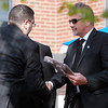 Salem: Allen Collier, right, shakes hands with Chris Raso, as he receives a plaque in honor of his son, Officer Sean Collier, the MIT officer who lost his life in the line of duty on April 18, 2013.  David Le/Salem News