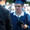 Peabody: Peabody High School graduate Chris Cennami shakes hands with Peabody Mayor Ted Bettancourt after receiving his diploma on Friday evening. David Le/Salem News