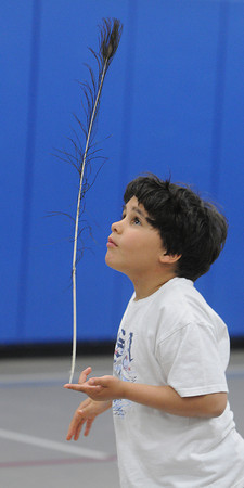 Beverly:<br /> North Beverly Elementary School student Kayne MacKenzie balances a large peacock feather. Nettie Lane, a clown and acrobat from Circus Smirkus, the youth circus from Vermont, taught students how to juggle, spin plates and perform other circus tricks as part of the North Beverly Elementary School's sixth annual Fitness Festival.<br /> Photo by Ken Yuszkus/Salem News, Thursday May 23, 2013.