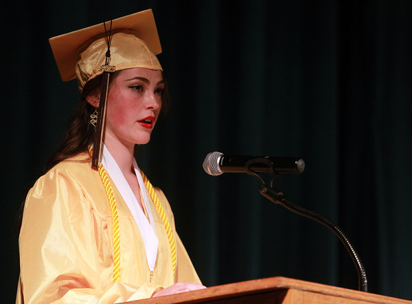 Peabody: Bishop Fenwick senior class president Jennifer Jordan gives her opening remarks to her classmates and a packed auditorium at the start of Commencement on Friday evening. David Le/Salem News