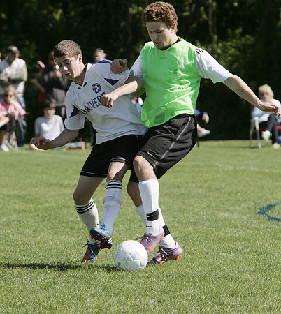 Danvers:<br /> Danvers' Justin Blanch and Beverly's Elias Crandell duel over the ball during the Beverly Banshees vs the Danvers Panthers U16 soccer game at the Danvers Invitational Tournament held at Danvers High School.<br /> Photo by Ken Yuszkus/Salem News, Monday May 27, 2013.`
