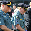Salem: Capt. Craig Martin, and Srgt. Rich Sullivan, from the MIT Police Department, bow their heads during a moment of prayer in memory of MIT officer and 2009 Salem State grad Sean Collier, during a memorial service on Monday afternoon. David Le/Salem News